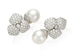 A pair of diamond and cultured pearl ear pendants by Tiffany  Co. #christiesjewels