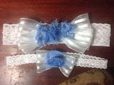 Pearls and glass seed beads are nestled between the petals of the cornflower blue flowers,white shadow stripped ribbon adorns each side. on Etsy, $50.00