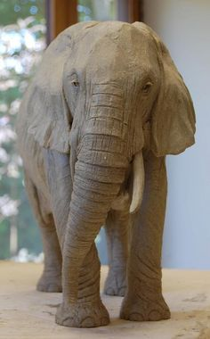 I've just finished this Wonky-tusk elephant sculpture this morning, her baby is to follow.  http://clayanimalsculptures.co.uk/project/elephant-sculptures