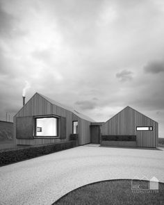 Annabelle Tugby Architects // Cedar clad barn dwelling in the landscape with corten steel screens and corner glazing. Black and white architectural visual by Matt Clayton.
