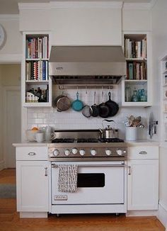 Love the built in shelves next to the stove, fill in around stove once moved? Cookbook storage