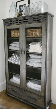 large rustic cupboard with glass doors, great for storage