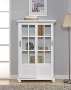 Altra Bookcase with Sliding Glass Doors in High Gloss White - modern - bookcases - by Wayfair