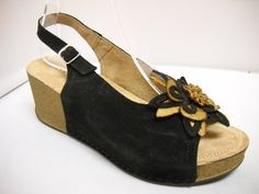 Atema from Europe. Suede slingback with a flower detail at front. Cushioned wedge on a heel height. Available in Black, Camel, Mango, Navy, Purple and Yellow. Tango Shoes, Black Camel, Summer Shoes, Cork, Mango, Footwear, Europe, Wedges, Italy