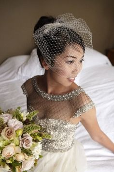 bride in Lattice Pearls Beaded Bodice Gown by Collette Dinnigan and birdcage veil