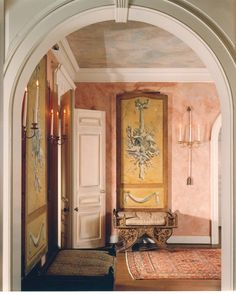 DESIGNER HUTTON WILKINSON, TONY DUQUETTE INC. USED TROMPE L OIEL PANELS FROM AN ELSIE DE WOLFE INTERIOR AND CARVED BENCHES WHICH HE PURCHASED FROM THE ELSIE DE WOLFE VILLA TRIANON SALE IN PARIS TO DECORATE THIS ENTRANCE HALL.  THE BENCHES WERE PURCHASED BY DE WOLFE ON HER TRIP TO INDIA WITH SYRIE MAUGHAM TO VISIT THE PRINCE KARAM AND PRINCESS KARMASITA OF KAPURTALA.
