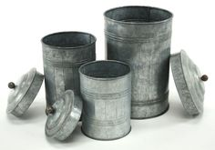 This handsome and rugged set of canisters are as attractive as they are unique. Crafted from galvanized metal, these canisters will look like they've come straight from the metal shop to your home! No finish or embellishments are made to the raw materials, so some canisters may contain a numerical stamp identifying the metal material, which adds to the character of these canisters (see image of large canister). Not for food storage.