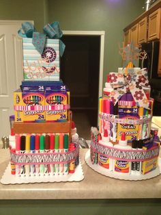 "School supply ""cakes"".... another end of the year teacher gift. Supplies: paper mache (sp?) boxes, scrapbook paper, ribbon and lots and lots of school supplies!"