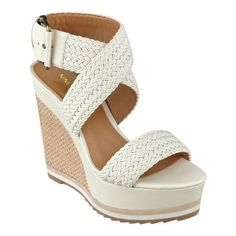"High rise. From work to weekends a pair of classic wedge sandals gets the job done. Woven crisscross design with an adjustable buckle on the ankle strap. Padded footbed for all-day comfort. Leather upper. Man-made lining and sole. Imported. 1 1/2"" platform. 5"" wedge heels."