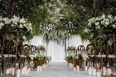 With glittering candlelight and a spectacular canopy of greenery, we've decided there is no ceremony setup more perfect than this one!   Photography By: MPSG Weddings.   WedLuxe Magazine   #wedding #luxury #weddinginspiration #luxurywedding #floral #decordesign #floraldesign #ceremony #eventdesign #design