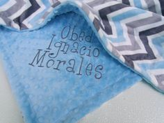 Silver, charcoal, and baby blue chevron with a blue minky dot back, this beautiful blanket is made of two fluffy layers of Korean minky dot, the