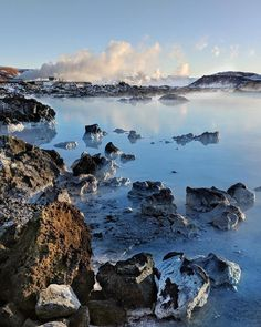 Silica has decorated the lava rocks surrounding the Blue Lagoon Blue Lagoon, Year Old, Iceland, Lava, River, Places, Rocks, Outdoor, Instagram