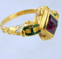 Cast gold ring with enamel, and a garnet. Probably Spanish ca 1600.