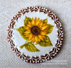 painted sunflower cookie with interesting border