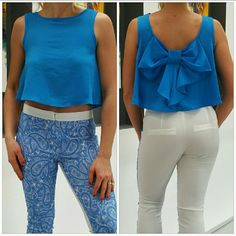 """HOLD Playful blue crop top NWOT Brand new no tags Fun and playful blue crop top. Light weight and breezy material.Pair with shorts and sandals, with pants and heels or even over your favorite dress!! Fun bow detail in the back makes this top just adorable!! Length in front approx 16.5"""" Length in back approx 18"""" Bust approx 20"""" seam to seam 98%polyester 2%spandex Size large  No trades Price is firm  *modeled in a small* Tops"""