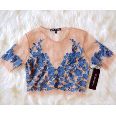 """FOR LOVE & LEMONS Crop Top Floral Embroidered Mesh Size Medium. New with tags.  $158.00  AUTHENTIC sheer embroidered top with jersey lining. Nylon/poly/spandex.   Measurements for Size Medium (garment flat):  Length: 17"""" Underarm to Underarm: 16.5"""" Sleeve: 9.5"""" Bottom opening: 15""""   Availability: Blue/Nude: Size Medium.   ❗️ Please - no trades, PP, holds, or Modeling.   ✔️ Reasonable offers considered when submitted using the blue """"offer"""" button.    Bundle 2+ items for a 20% discount…"""