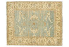 A timeless beige and blue area rug is the perfect accent to any classic living room or bedroom.
