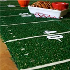astro turf type rug from the dollar store + white tape + white sticker numbers = football field / baseball field / soccer field decor