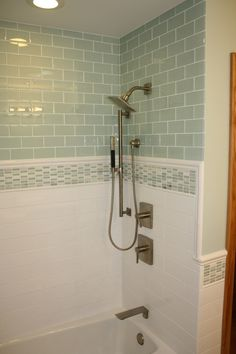 Bathroom tile in pale green... with white tile on bottom...