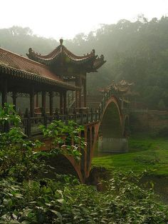 Bridge in the mist, Leshan, China. Leshan is a prefecture-level city located at the confluence of the Dadu and Min rivers in Sichuan Province. Places To Travel, Places To See, Travel Destinations, Holiday Destinations, Places Around The World, Around The Worlds, Beautiful World, Beautiful Places, Giant Buddha