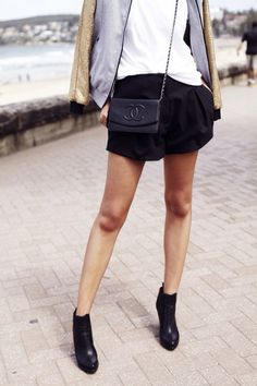 Black booties with a tee, black shorts, and Chanel mini