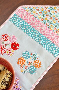 It's my turn today on the Penny Rose Fabrics blog, where I am sharing a tutorial to make this sweet English Paper Pieced applique table runn...