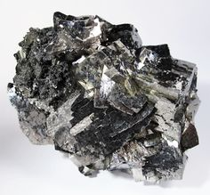 Arsenopyrite is an iron arsenic sulfide. It is a hard metallic, opaque, steel grey to silver white mineral . When dissolved in nitric acid, it releases elemental sulfur. When heated, it becomes magnetic and gives off toxic fumes. It is a principal ore of arsenic. When deposits of arsenopyrite become exposed to the atmosphere, usually due to mining, the mineral will slowly oxidize, converting the arsenic into oxides that are more soluble in water, leading to acid mine drainage.