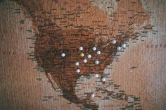Make a DIY corkboard map to document your travels! This DIY map art is fun and easy and inexpensive to make.