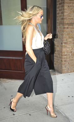 Kate Hudson: Bohemian style goddess Kate dressed up a casual tank with her sleek black culottes and sexy heels.
