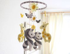 Baby Mobile - Nursery mobile - Giraffe Zebra Mobile - Jungle Mobile -  Choose Colours -  MADE TO ORDER by FlossyTots on Etsy https://www.etsy.com/listing/196514504/baby-mobile-nursery-mobile-giraffe-zebra