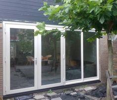 Openslaande deuren en grote ramen achterpui Kroon Kozijn Heemskerk