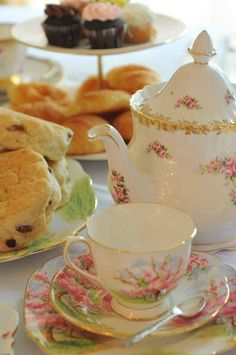 Tea with scones, strawberry jam and clotted cream!  There is just no taking the English girl out of me. This pic makes me smile from ear to ear!