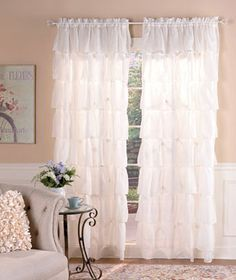 "Give your windows a full, fashionable look with a Gypsy Ruffled Window Curtain. Layers of ruffles with lightly textured crinkles in each sheer panel bring a sophisticated chic to any room. Panel has a rod pocket for easy hanging. Select from 60"" x 63"" an"