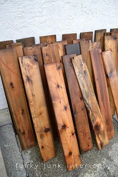 Washing old pallet wood. This wet wood lets you know how it would look if it was stained!