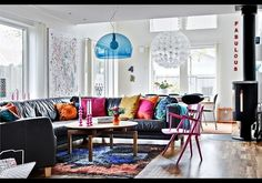 Sneaky, I like it! Boy colors are boring, and Im outnumbered! Love the bright pillows on black couch