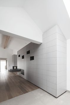 Penthouse V is a holiday home for a family of seven in Pörtschach, Austria. The Austria based studio destilat positioned the penthouse in the roof structure of a cinema. Arch Interior, Interior Architecture, Interior Design, Interior Ideas, Wall Design, House Design, White Wall Paint, Pent House, Luxury Apartments