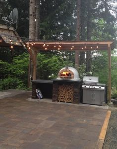 Outdoor pizza oven fireplaceOutdoor pizza oven fireplace options and ideas HGTVPIZZAIOLI PIZZA OVEN ** BEST SELLER ** Patio with outdoor kitchen, pizza oven and bar, Weston, CT .Patio with outdoor kitchen, Outdoor Kitchen Countertops, Outdoor Kitchen Bars, Backyard Kitchen, Outdoor Kitchen Design, Small Outdoor Kitchens, Patio Design, Oven Diy, Pizza Oven Outdoor, Brick Oven Outdoor