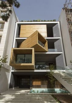 Sharifi-Ha house in Tehran by Nextoffice  The house has three huge rooms that resemble wooden cubes. Depending on weather conditions and the desire of owners, they may be turned to the street at 90 degrees. The facade turns from two-dimensional to three-dimensional state.