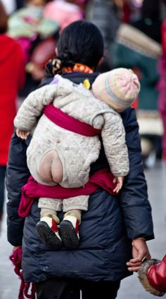 Tibet Brilliant idea instead of diapers. Time for the western world to use this mode and stop filling the landfills with diapers.