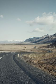 Want to ride this road early, sitting easy on a Harley, drinking in the quiet, barren drift of the land going by at 90 mph!