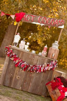 How gorgeous is this hot cocoa stand! If only we were that creative to make a stand such as this! I love the red and brown color scheme for this theme! I also love the idea of chocolate milk from a glass dispenser!