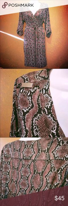 Calvin Klein Wrap Dress  NWOT, never worn.  Classy and sexy... This dress is 98% polyester and 2% spandex for a gorgeous body hugging fit.  It is a wrap dress, silver hardware on shoulders and sleeves, hits on the knee or just above.  Python print.❤️ Calvin Klein Dresses Midi