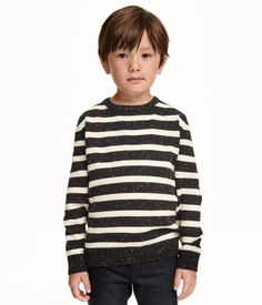 Fine-knit cotton sweater with long sleeves.