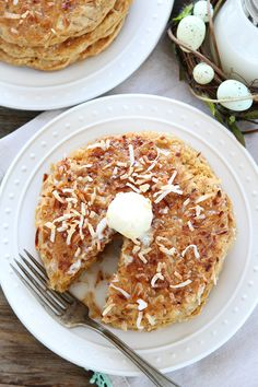 Toasted Coconut Pancakes Recipe on twopeasandtheirpod.com Light and fluffy pancakes with a sweet toasted coconut topping! Our family LOVES these pancakes!