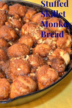 Stuffed Monkey Bread in Cast Iron Skillet using Rhodes Frozen Dinner Rolls. http://recipesforourdailybread.com/2013/04/27/stuffed-monkey-bread/