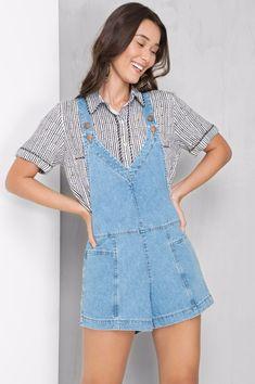 Jardineira jeans recortes