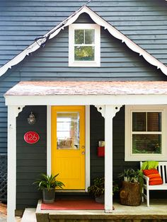Yellow door with greeny gray exterior paint; love this and love the house number