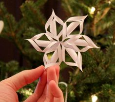 paper stars - step by step.  Use different size papers (wrapping paper and scrapbook papers work excellent!