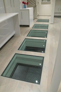 Glass floor photo gallery glass walls stairs floors for Glass deck floor