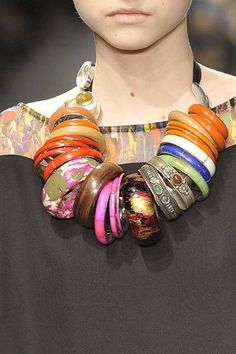 Dries Van Noten, 2008 - how to wear all your cuff bracelets around the neck!